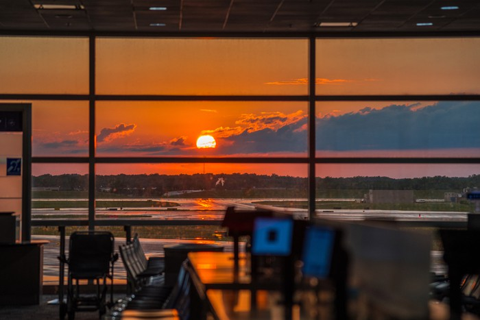 Detroit airport sunset time , USA
