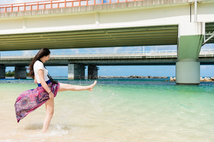young lady playing in Naminoue Beach.