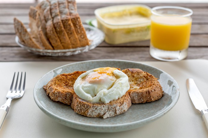 Breakfast fried eggs on toast with orange juice a