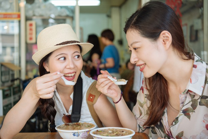 japanese friends eating Asian delicious food