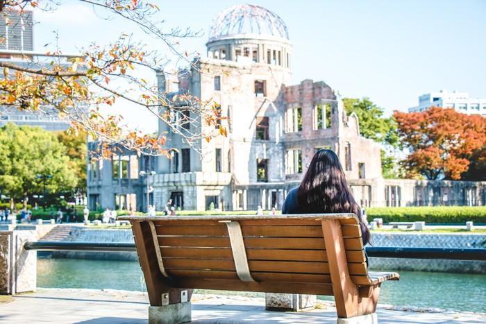 Girl look at Atomic Dome, Hiroshima Peace Memorial