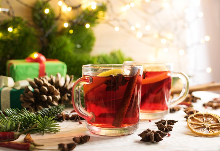 Winter red drink with spices on festive new year