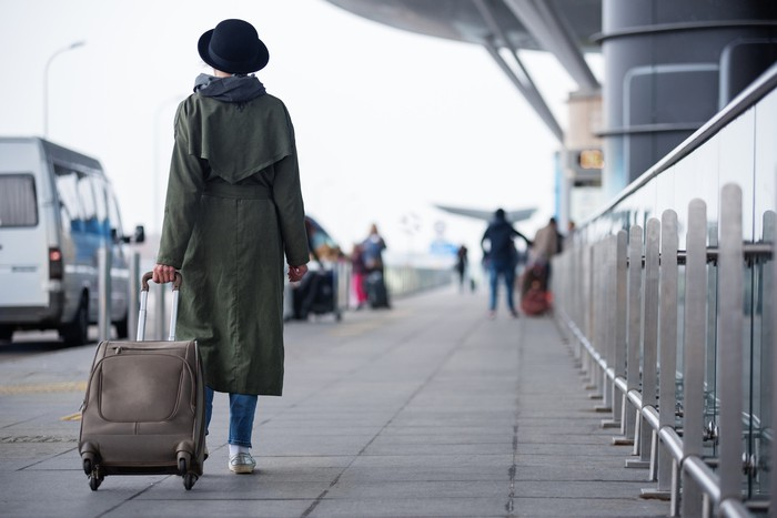 Stylish woman is going to travel
