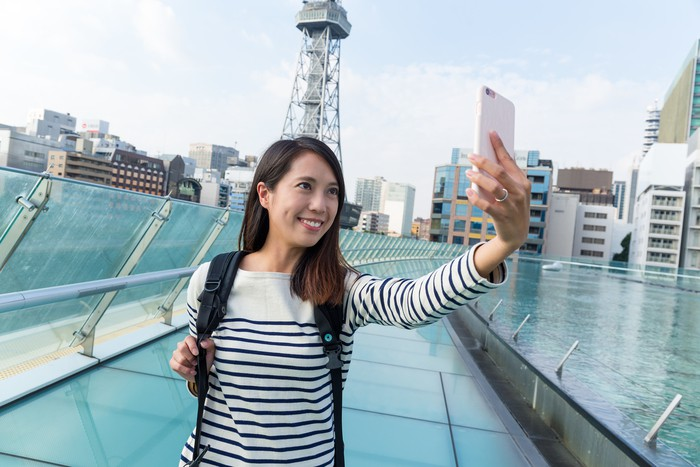 Woman taking selfie with mobile phone in Nagoya city
